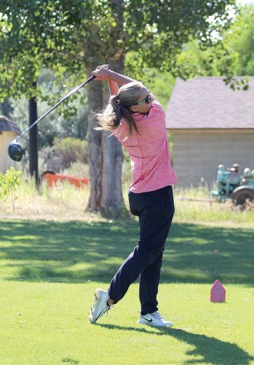 Greybull freshman Erika Cook tees off on the fourth hole during a practice at Foster Gulch Golf Course. Cook won the Worland Invitational with a score of 171.