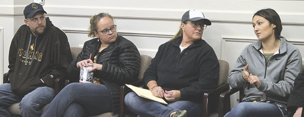Barbara Anne Greene photo    New fair board members (l-r) Austin Layne, Tracy Haley and Kelli Mercer listen to Paintrock FFA advisor Ashley Spatz during the boards first meeting with the commissioners.