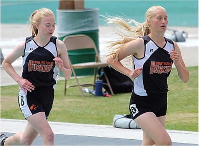 Sam Smith Burlington senior Cheri Henderson and Julia Nelson pace themselves along during  the 1,600-meter run Saturday in Casper. Nelson placed fourth in the mile with a time of 5:56.94, and Henderson placed fifth with a time of 5:56.97.